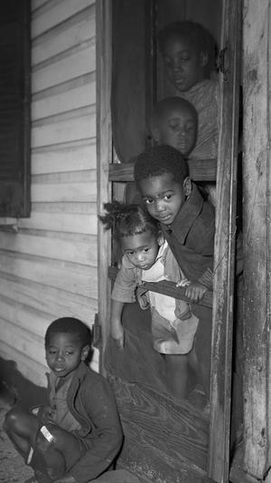 Negro Children in the Front Door of their Home